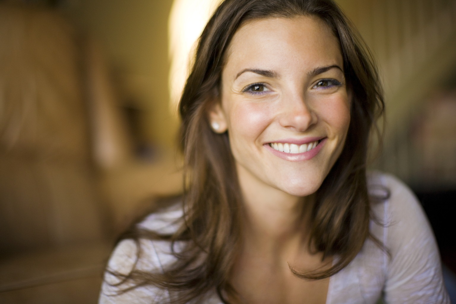 Portrait of woman smiling indoors