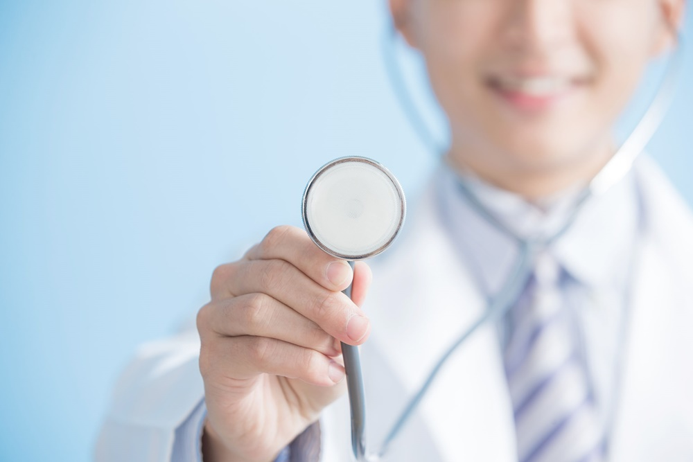 67703613 - male doctor show stethoscope to you, asian